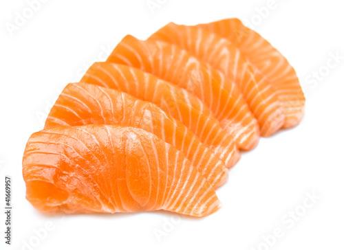 Isolated raw sliced salmon