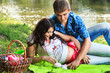 Pregnant pretty young girl with her husband in a couple having a