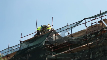 Two Workers on Scaffolding