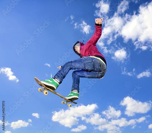 Skateboarder high in air