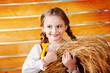 Beautiful girl holding ears of wheat
