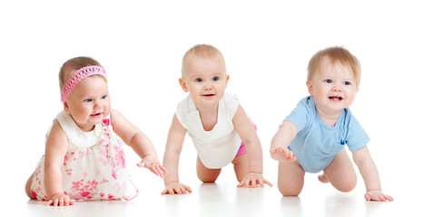 Funny babies go down on all fours. Competition concept.