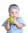Baby girl holding green apple, isolated on white