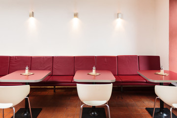 Empty seats in red colored restaurant