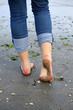 woman walking on the wet sand