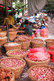 Vegetable market with bacskets of onions in Yangon, Myanmar