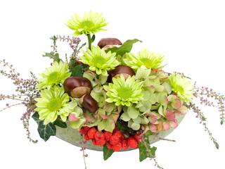Modern autumal flower arrangement on white