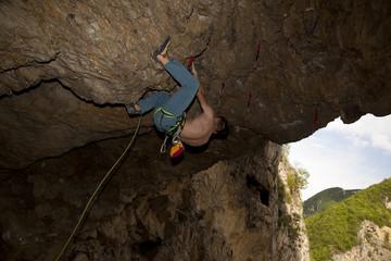 Young man climbs