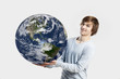 Handsome young man holding the planet earth on its hands