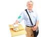 A smiling postman delivering letters