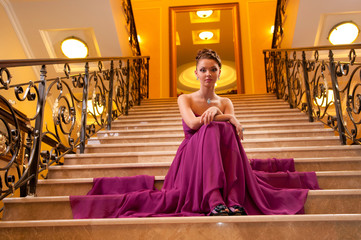 woman in a long dress on the stairs