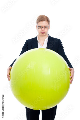 Funny businesswoman with exercise ball
