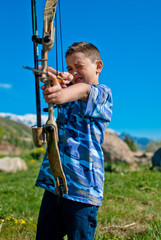 A young boy shooting archery
