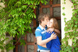Young loving couple kissing by the door