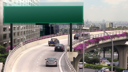 A flyover with empty high tech traffic signboard