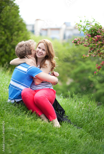 Young happy couple having fun together in park