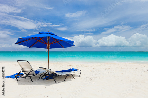 Two chairs under umbrella