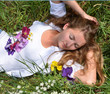 Young, beautiful woman sleeps in the meadow