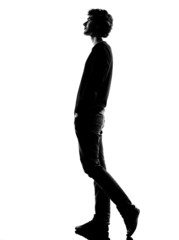 young man silhouette walking