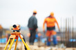 surveyor equipment level at construction site
