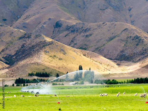 Fotobehang Irrigating lush farm pastures in central Otago, NZ