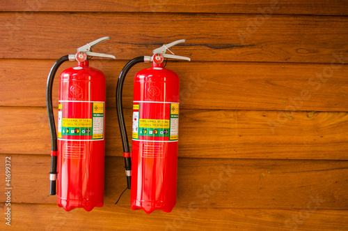 extinguisher on wooden wall
