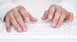 Close up of human hands typing at the keyboard