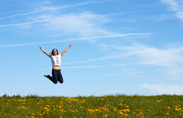 happy smiling girl jumping against blue sky