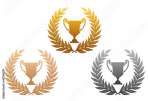 Golden, silver and bronze laurel wreaths with trophy
