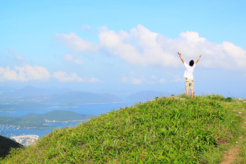 Beautiful mountains landscape with lake in hongkong and man on t