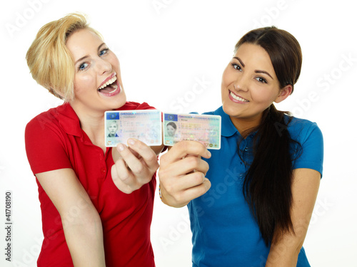 Two girls are happy to get a driver licence