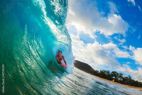 cialo-boarder-surfing-blue-ocean-wave