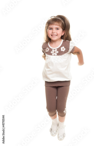 cute little girl jumping in the studio