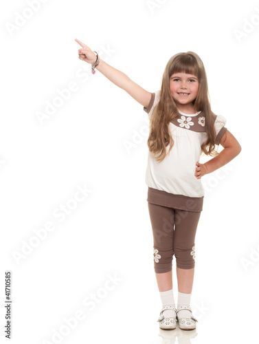 cute little girl pointing up somewhere and smiling