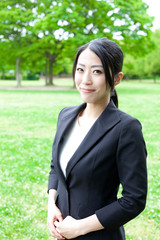 asian businesswoman in the park