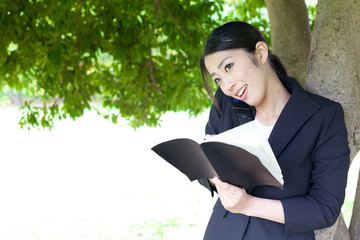 asian businesswoman working in the park