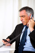 Hispanic senior business man calling on telephone
