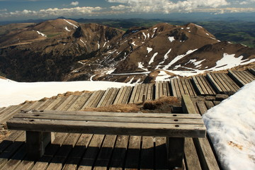 wooden bench at Puy de Sancy summit