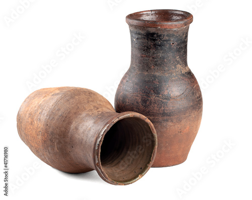 two ancient pitcher on a white background