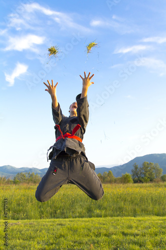 Ninja girl throwing grass in the air