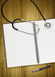 stethoscope notepad and pen
