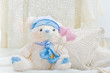Stuffed teddy bear toy with hearts and pillows