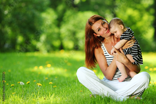 Mother and daughter on the green grass