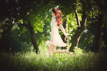 redhead woman in the wood