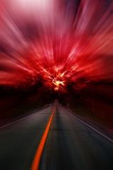 Blurred asphalt road and red bloody blurred sky