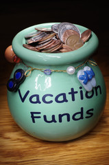 Jar Holding Coins for Vacation Fund