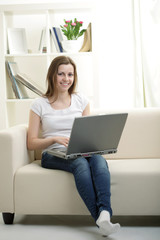 beauty girl with laptop in room
