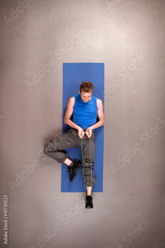 Overhead view of exercising fit man in studio