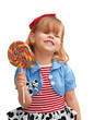 Happy girl smiling and holding lollipop