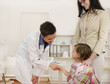 Pediatrician shaking hand with girl child patient